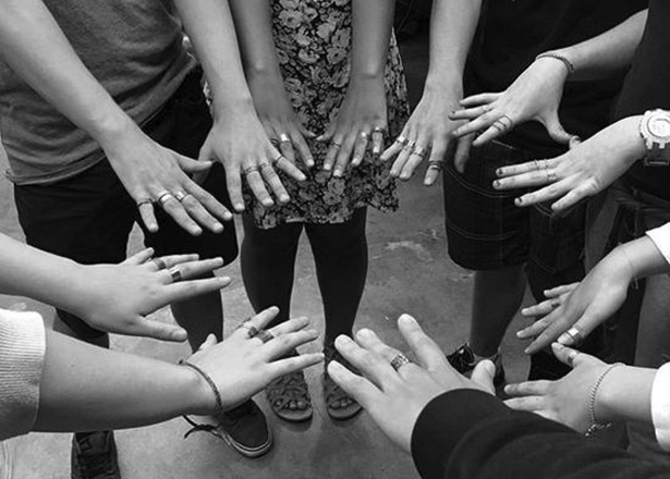 circle of hands with rings on them